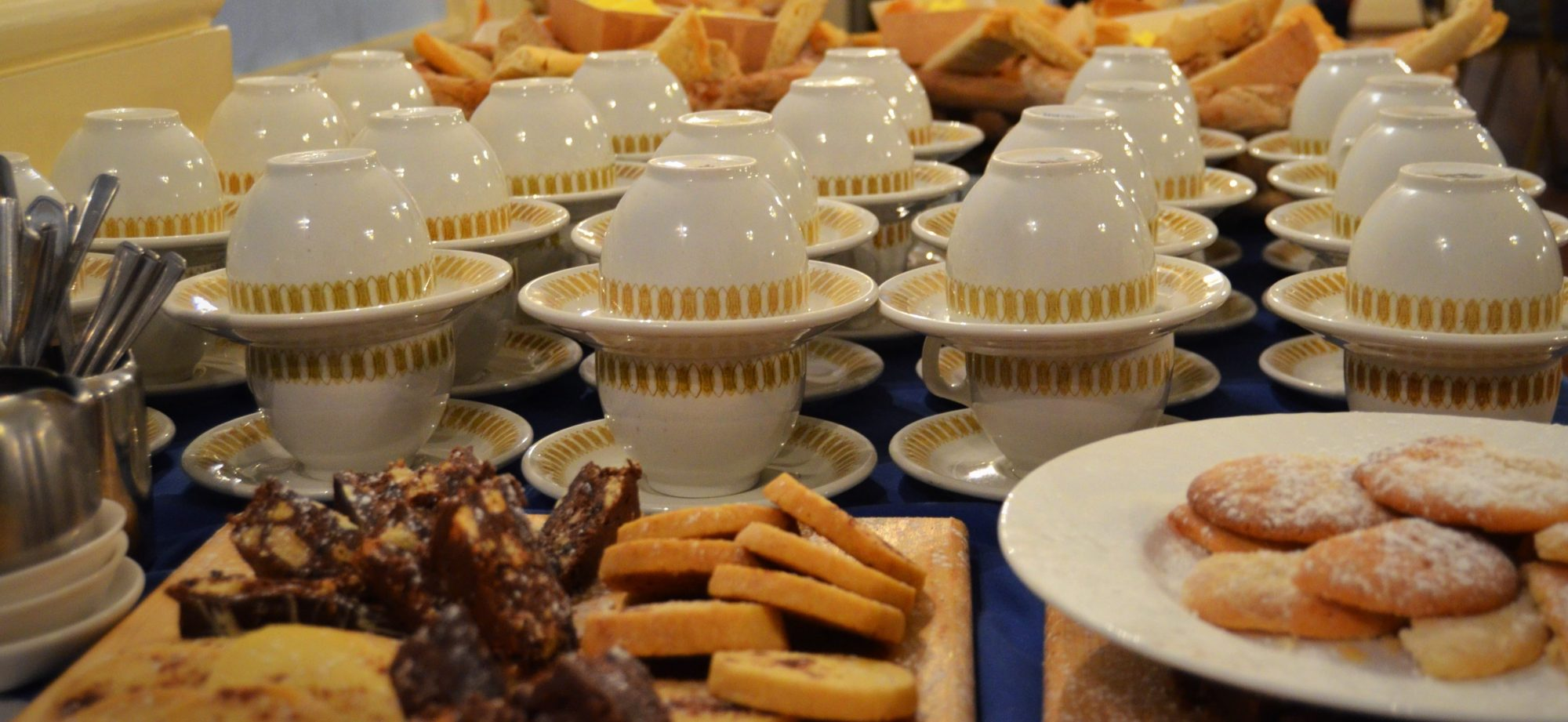 Coffee cups and biscuits at a networking event