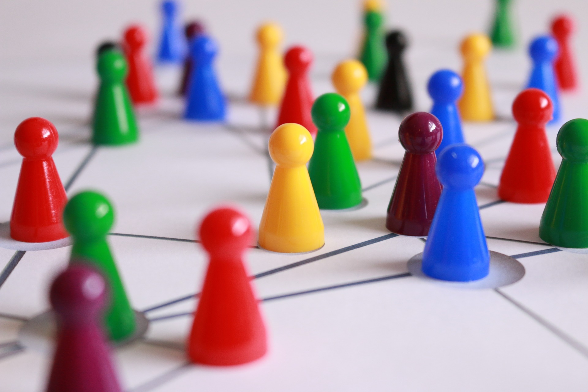 Network of brightly coloured plastic pawn pieces